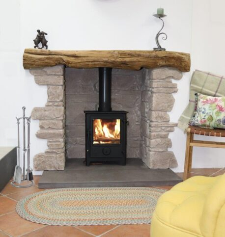 Dartmoor 5 Se 5 kW Woodburning Stove with honed black granite hearth.